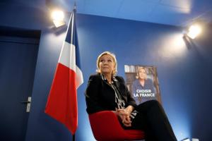 Marine Le Pen speaks during an interview with Reuters in Paris. In an interview with Reuters ahead of Sunday's decisive second round, Le Pen reaffirmed she wanted to take France out of the euro and said she hoped the French people would have a national currency in their pockets within two years. REUTERS/Charles Platiau