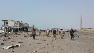 Southern Resistance fighters gather in the al-Alam entrance of Yemen's southern port city of Aden, after taking control from Houthi fighters