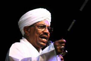 Sudan's President Omar Hassan al-Bashir speaks to the crowd after a swearing-in ceremony at green square in Khartoum