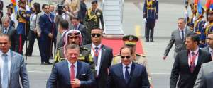 In this photo provided by Egypt's state news agency, MENA, Egypt's President Abdel-Fattah el-Sissi, center right, welcomes Jordan's King Abdullah II, to Cairo International Airport, Egypt, Wednesday, May 17, 2017.