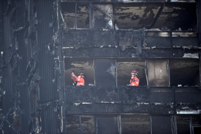 Over 50 Possibly Killed in London Tower Fire, PM May Admits Failings