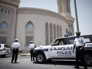 Bahrain Police officers standing near police vehicles in 2011 in Bahrain