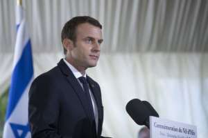 "President Emmanuel Macron last week promised ""clarity on the death of Sarah Halimi."" But critics complain of societal doublespeak. (Pool photo by Kamil Zihnioglu/European Pressphoto Agency)"
