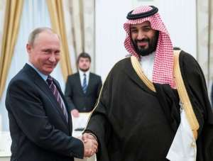 Russian President Putin shakes hands with Saudi Deputy Crown Prince and Defence Minister bin Salman during a meeting at the Kremlin in Moscow