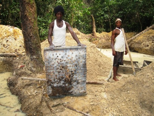 Diamond digger displaying a tool Liberia