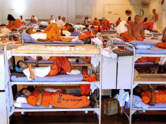 In this undated photo released by the California Department of Corrections, inmates sit in crowded conditions at California State Prison, Los Angeles. California's prison secretary on Friday, Feb. 2, 2007, said the state will force the transfer of up to 5,000 inmates to other states, an indication that an order signed last fall by Gov. Arnold Schwarzenegger has fallen short of expectations. Corrections Secretary James Tilton said the action is needed to relieve overcrowding that threatens the safety of guards and inmates in the nation's largest state prison system. (AP Photo/California Department of Corrections)