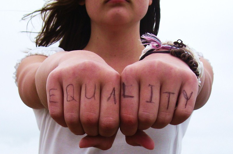 "photo of girl with the word ""equality"" written on her knuckles"