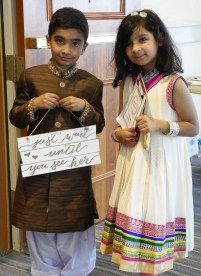 Kids Carry Wedding Signs