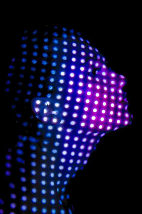 woman covered with polka dot lights