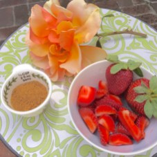Nourishing my sense of taste and 2nd chakra with an apricot colored Rose from the garden and a bowl of strawberries from my Good Life Organics farm box sprinkled with coconut sugar!