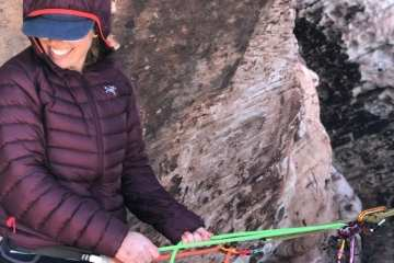 Erin Machan using the serenity in a top down belay configuration.