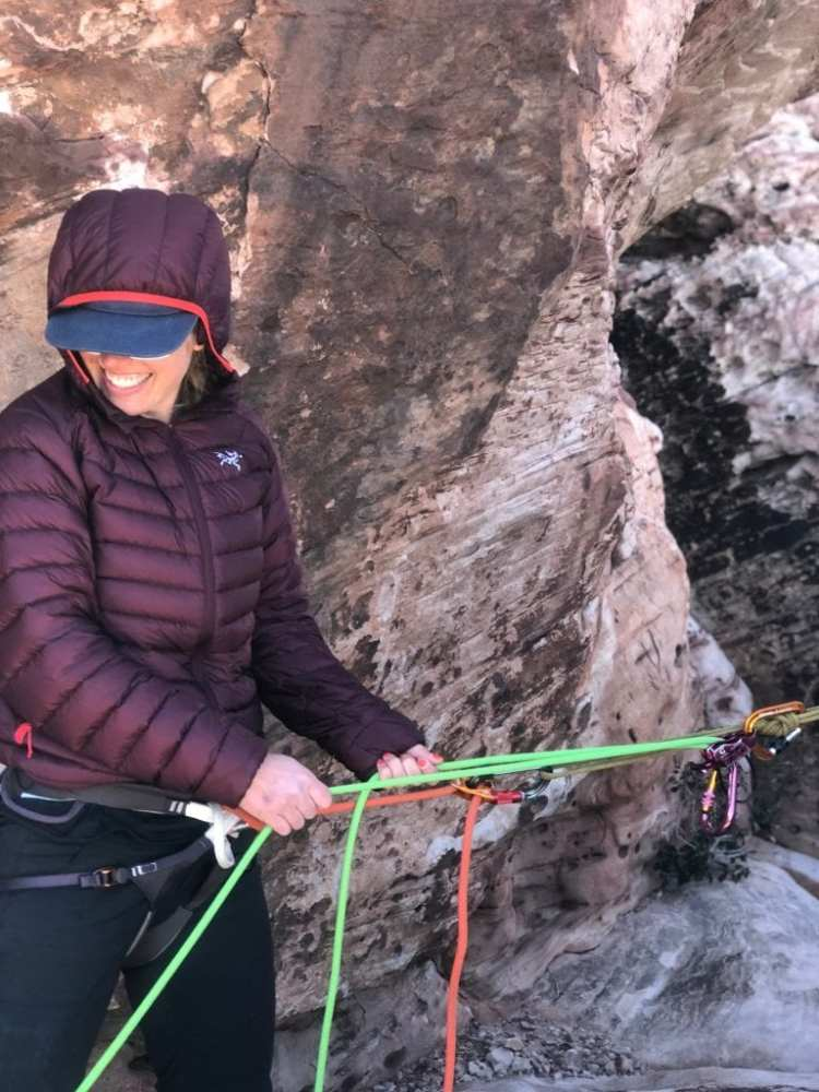 Erin Machan using the serenity in a top-down belay configuration.