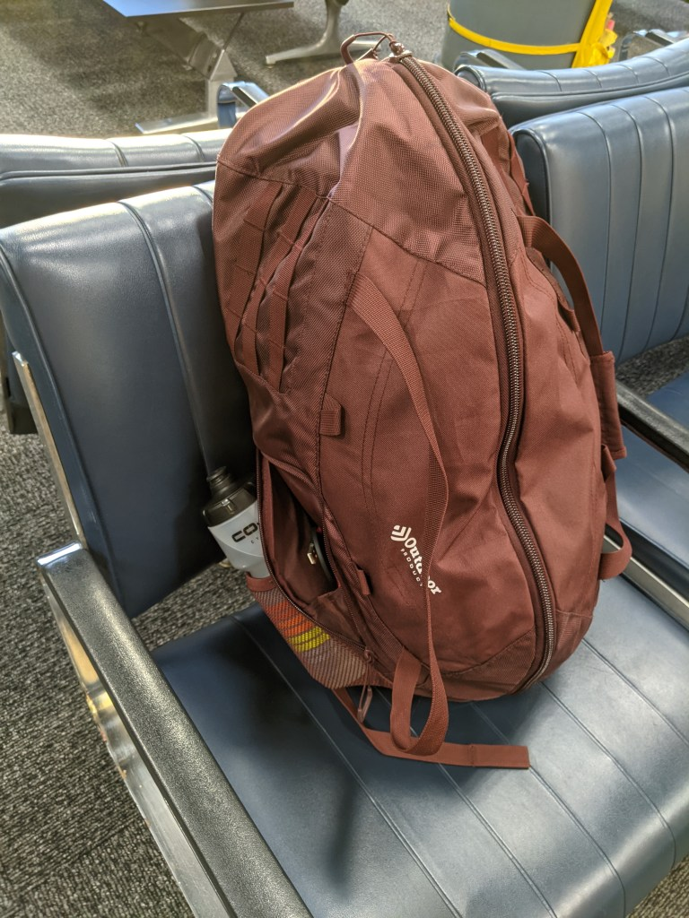 Outdoor Products Silverwood Duffel Backpack is an ideal carry-on bag. It fits in the overhead bins on small planes and has external zippered and mesh pockets so you can keep water bottles, headphones, etc handy
