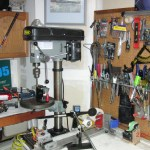 Pneumatic gripping station in foreground, drill press and shaft extractor in background.  Fully equipped and experience like a Tour Van.  Your clubs get the same treatment as the tour pro's when you utilize Engineered Golf's services.