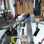 Gripping station with perfect face alignment jig.  Grips are properly aligned and often immediately usable to play golf.