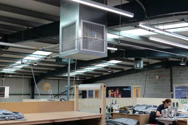 4-way grilles bringing fresh air into a factory mezzanine area.