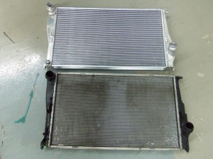 Mishimoto radiator (top) and stock radiator (bottom)