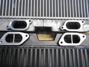 Stock (top) vs Mishimoto TMIC prototype, intercooler inlets