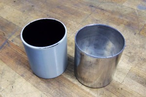 Fabricated catch can base (right) and 3D-printed base (left)