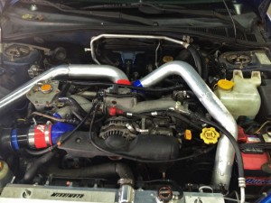 Mishimoto fabricated intercooler pipes on Bugeye