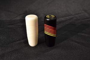 A view of our 3D printed prototype shift knob next to the final product.