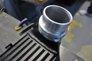 Machined intercooler outlet