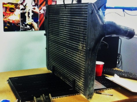 Intercooler with fin debris