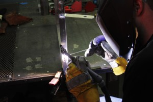 Welding overflow tank mounting points