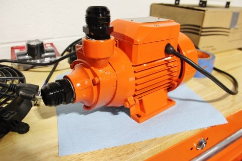 Water pump in Mishimoto orange