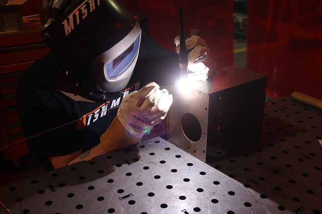 Welding together the parts to the prototype 2016 Civic intake