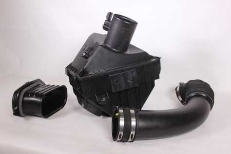 Components of stock Nissan Titan air intake