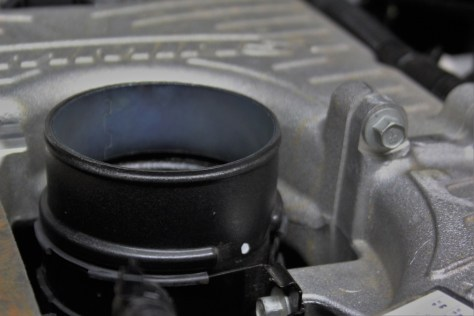 Throttle body from the stock Nissan Titan air intake