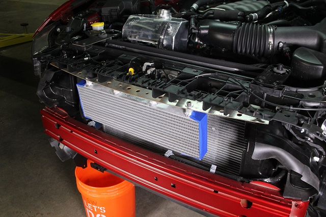 Test-fitting the Mustang oil cooler