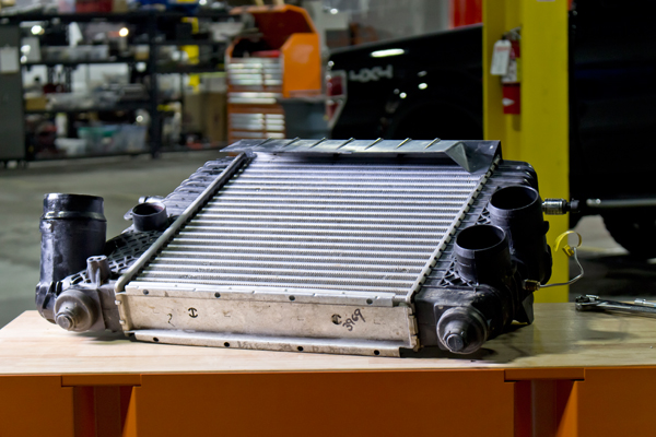 From this angle, you can get a pretty good look at the thickness of the factory intercooler