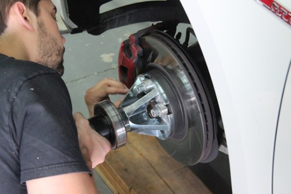 One of our engineers torqueing a wheel adapter on for our dynapack