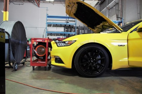 Mustang GT on the dyno for transmission cooler testing