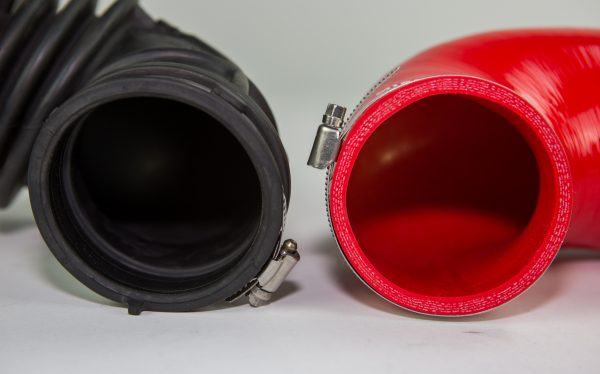 A side by side comparison of the stock and silicone induction hoses. our wire reinforced silicone construction not only holds its shape better, but will increase the lifespan of the hose.