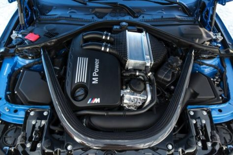 The 2014 BMW S55 engine, the cooler is located atop the engine bay