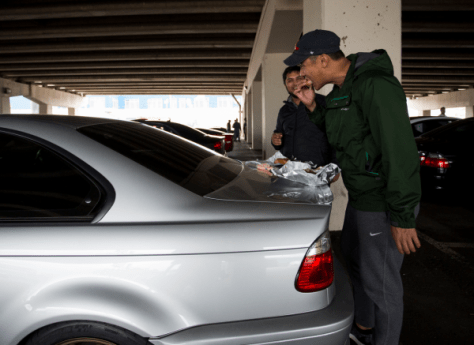 Yasser Ameen, left, and Aaron Han elected to use Han's E46 M3 trunklid for a table since seating across the street was limited.