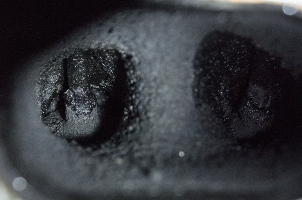 Example of valves covered in carbon deposits