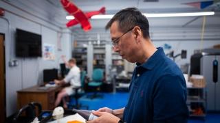 UVA Engineering researcher Joe Zhu assembles a robotic fish