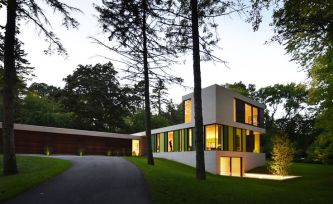 Dressed in green hues inspired by changing landscape colours_ 510 House by Johnsen Schmaling Archite. Rooted on a