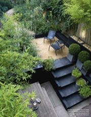 _ _ Black_ Charcoal_ lush green_ some pea gravel and a bit of decking _ perfect recipe for stunning .