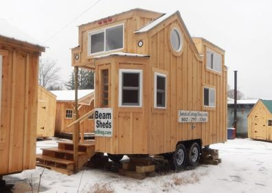 Check out this 8x16 tiny house on wheels for sale. Built for off grid living with a solar package_ composting toilet_ solid fuel heater & quality insulation.