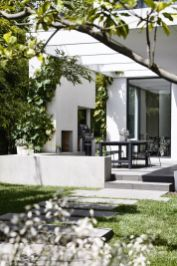 In the back garden_ the emphasis shifts to clean lines and modern silhouettes_ bamboo_ grape vines o.