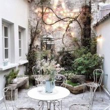 Pastels and climbing vines in this lovely European patio. Romantic French Country Garden Courtyard Ideas. _frenchcountry _courtyard _garden _provence _romantic