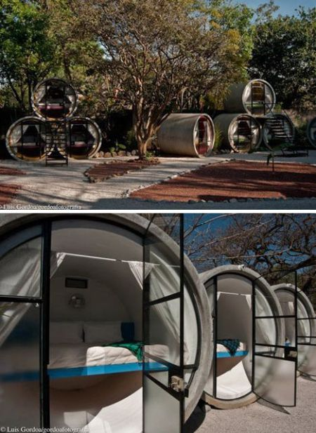 Sewer pipe bedrooms_ Perfect for guests__ they won_t overstay their welcome in this cozy space.