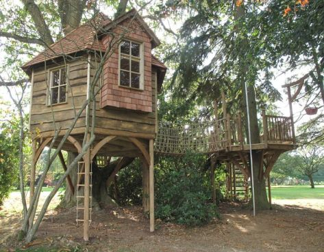 This tree house had been designed to encourage use by the whole family_ for children_s play and for . With climbin