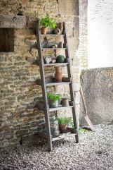 stepladder planter shelves _ Gardenista I_m pretty sure I could grab a broken ladder or old step st.