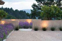 stuccoed walls_ 1_4_ crushed granite_ reeds_ lavender & lighting from _Landprints_ the Landscape Des